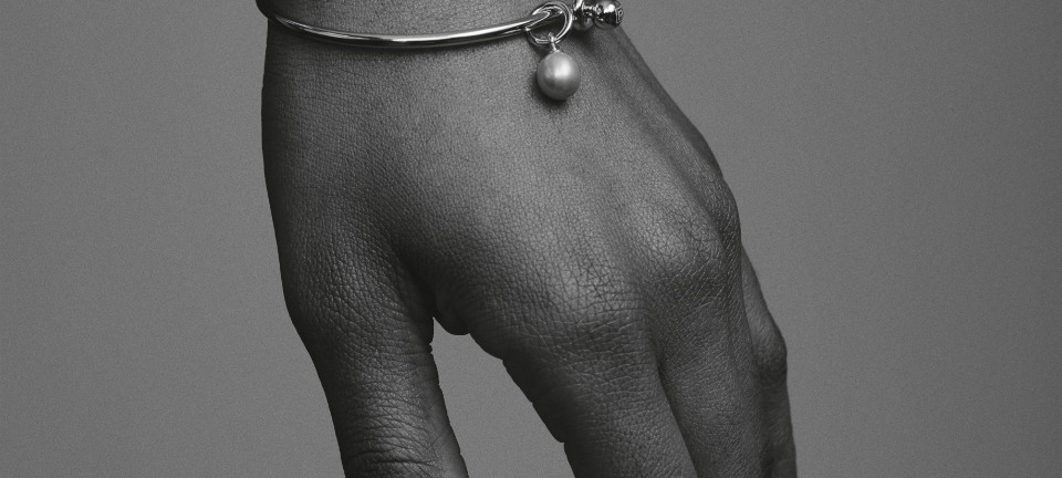 a hand dangling in black and white